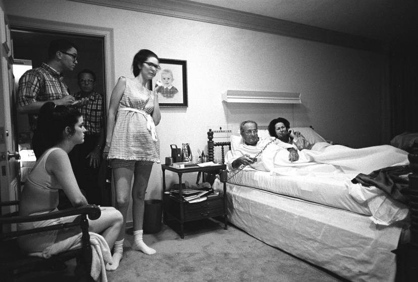 08/28/1968 Credit: LBJ Library photo by Yoichi Okamoto Event: Pres. Lyndon B. Johnson and family watch the Democratic National Convention on television Description: Watching the convention (L-R) Luci Johnson Nugent, Tom Johnson, unidentified, Lynda Johnson Robb; in bed: Pres. Lyndon B. Johnson, Lady Bird Johnson Location: President's bedroom, Texas White House, LBJ Ranch, Texas