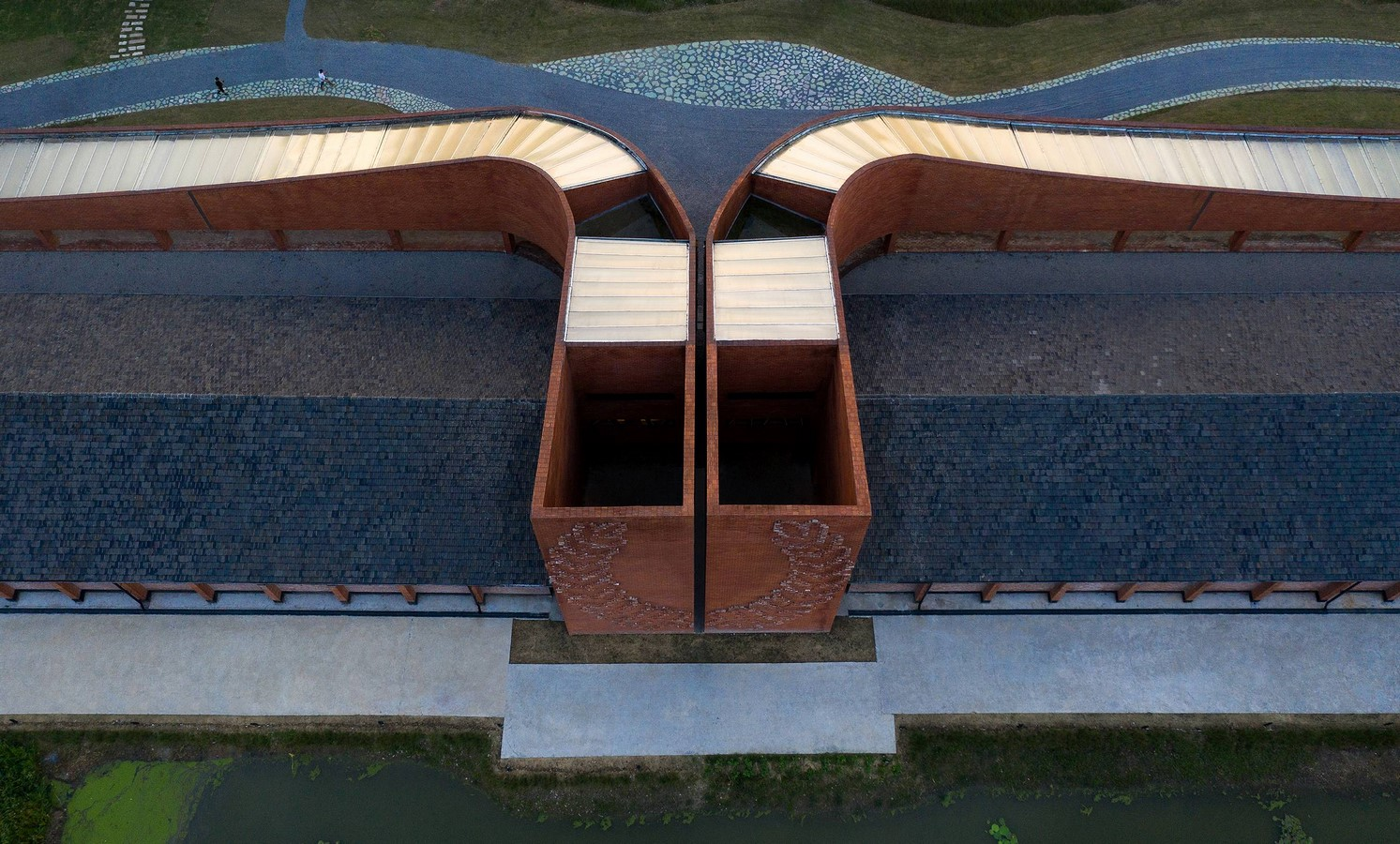 Old Granaries repurposed As An Art Centre With Flowing Brick Corridors In Jiaxing by Roarc Renew - Sheet8
