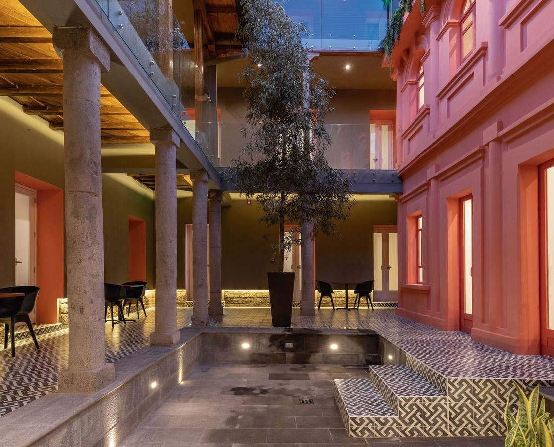 Old Building converted into a Hotel With Pinkish Walls And Central Courtyard In Quito by Nicolas & Nicolas - Sheet3