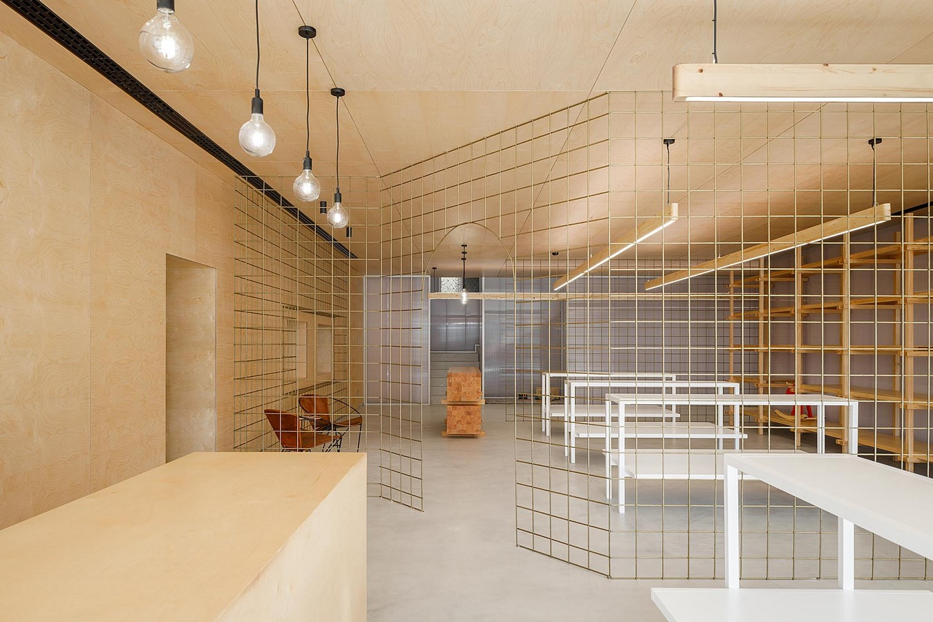 Interior Space divided with Golden Wire Meshes For Multiple Uses In This Store In Portugal by Stu.Dere- Sheet2