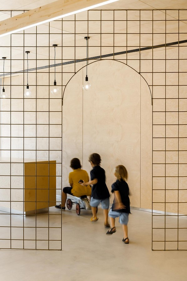 Interior Space divided with Golden Wire Meshes For Multiple Uses In This Store In Portugal by Stu.Dere- Sheet5