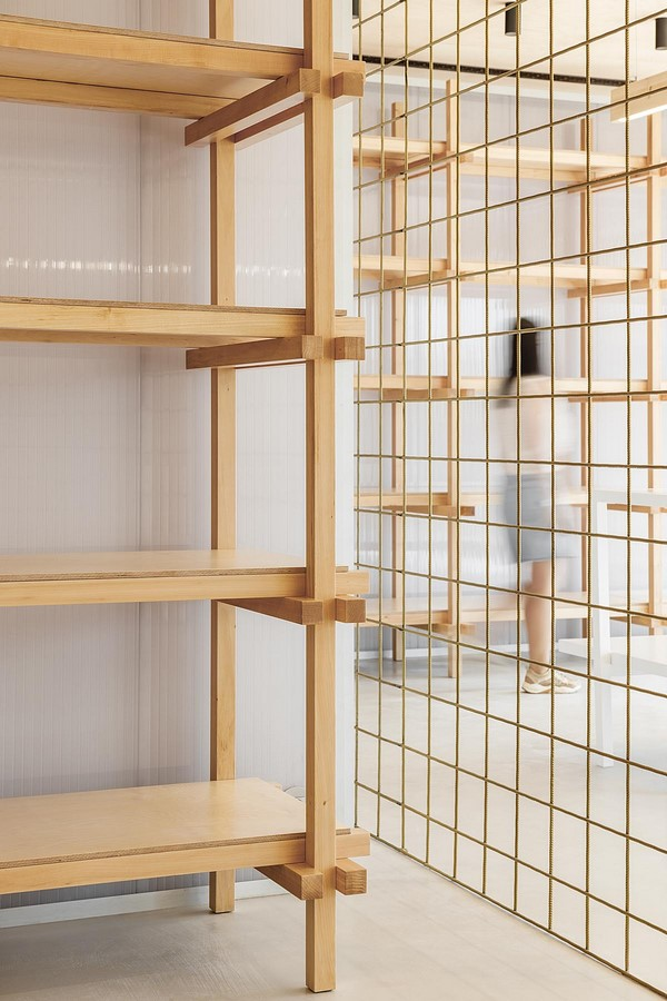 Interior Space divided with Golden Wire Meshes For Multiple Uses In This Store In Portugal by Stu.Dere- Sheet6