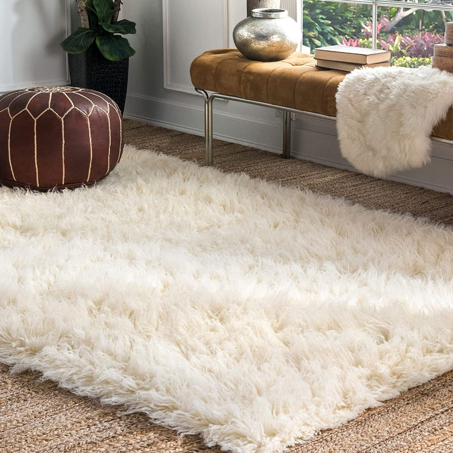 10 Ways to style rugs in your home! - Sheet9