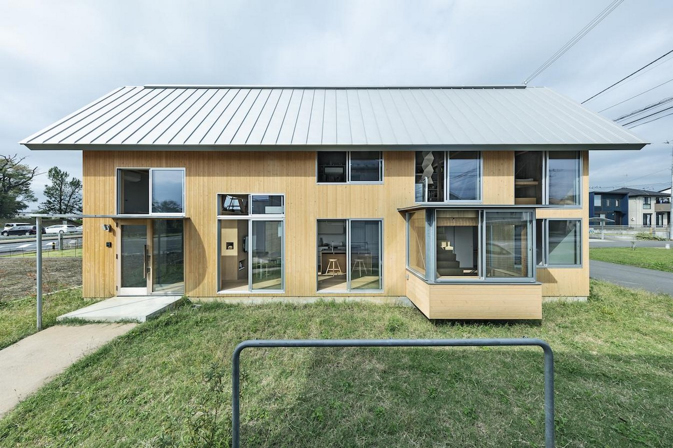 House in field' containing variety of living spaces beneath its gable roof designed by Ship Architecture - Sheet1