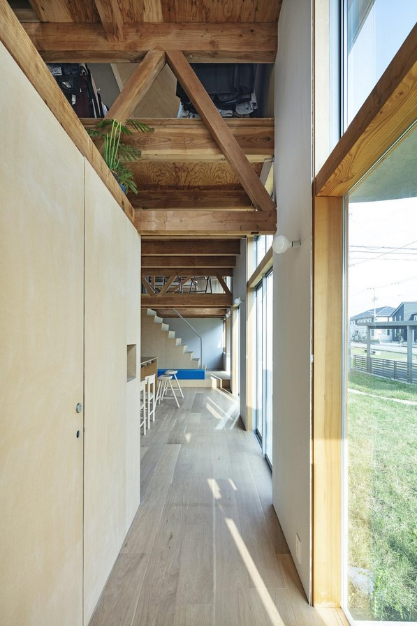 House in field' containing variety of living spaces beneath its gable roof designed by Ship Architecture - Sheet3