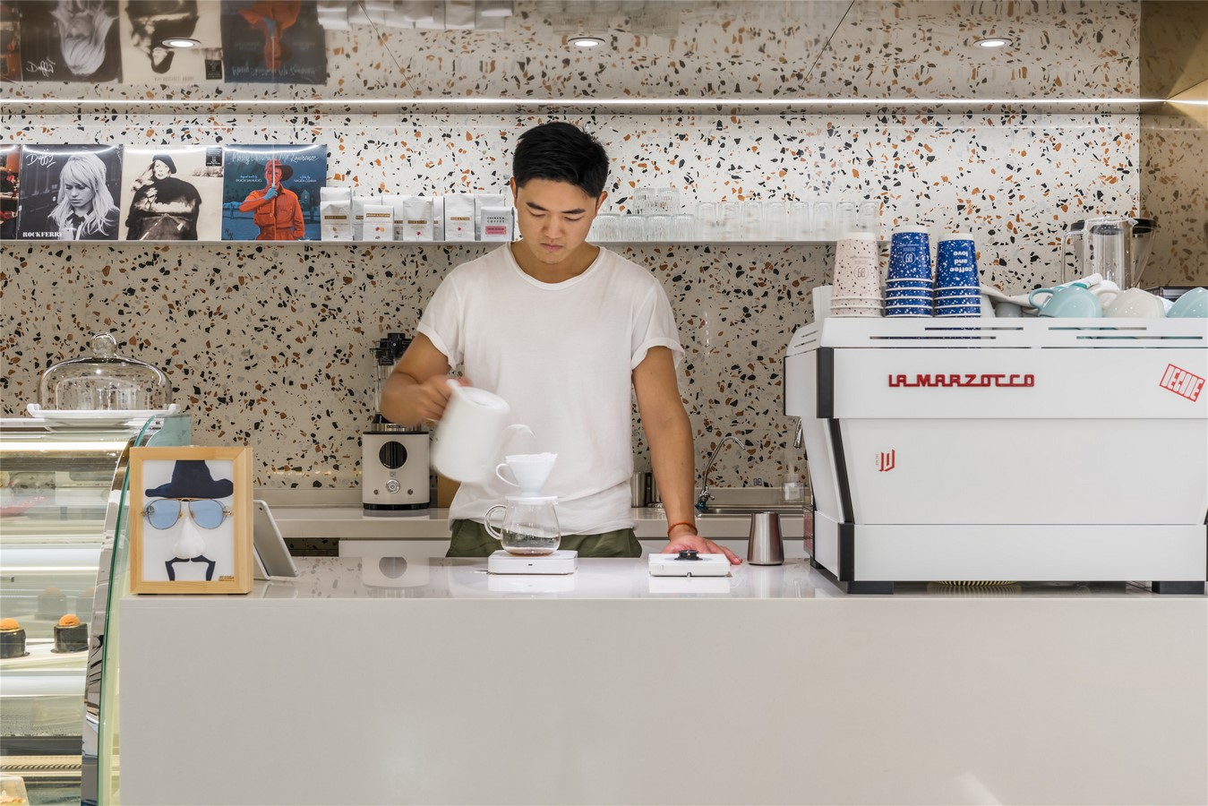 This Tiny Cafe is Dotted With White And Orange Interwoven Terrazzo Details In Tianjin is designed by TOUCH Design - Sheet2