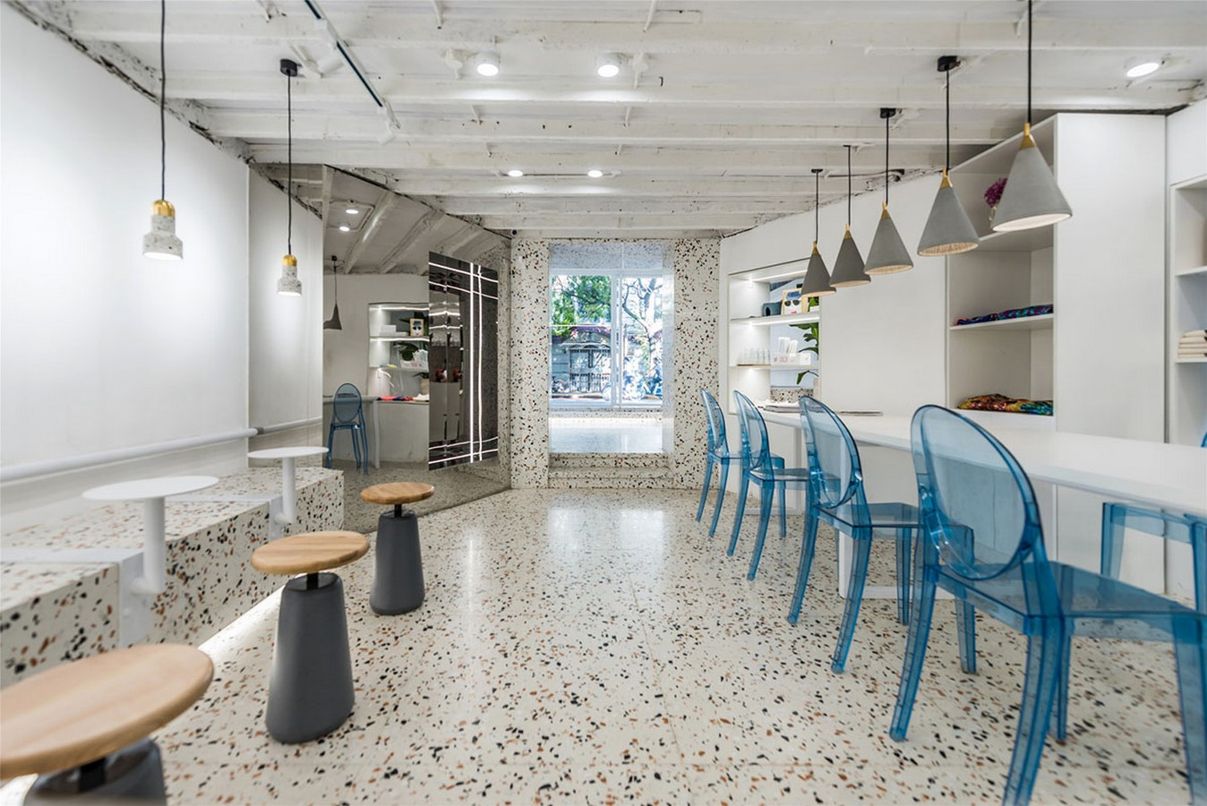 This Tiny Cafe is Dotted With White And Orange Interwoven Terrazzo Details In Tianjin is designed by TOUCH Design - Sheet5