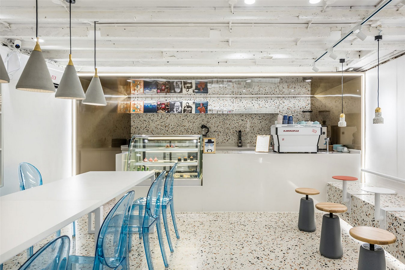 This Tiny Cafe is Dotted With White And Orange Interwoven Terrazzo Details In Tianjin is designed by TOUCH Design - Sheet6
