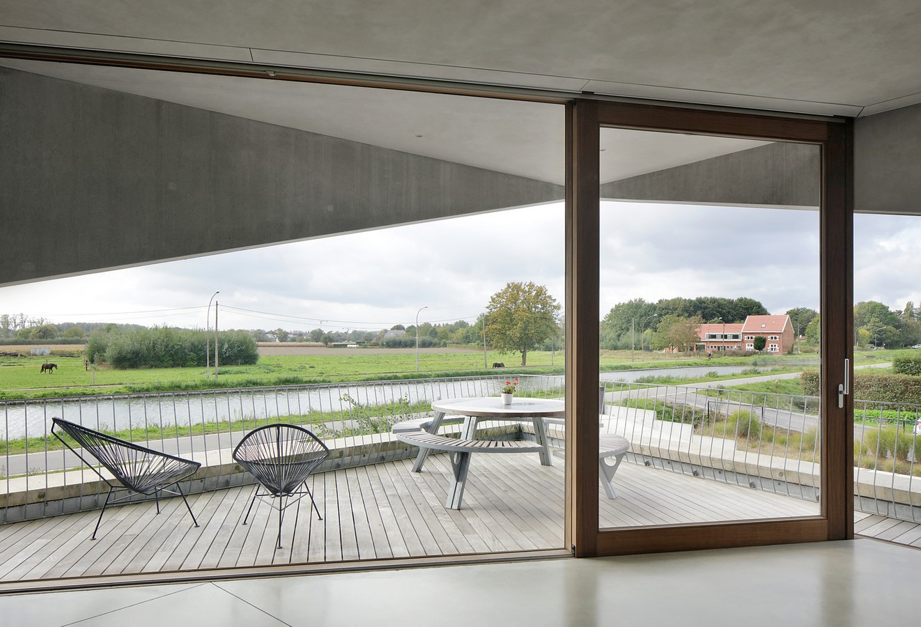 Belgian House Featuring Asymmetrical Angled Concrete Canopies designed by GRAUX & BAEYENS Architecten - Sheet13
