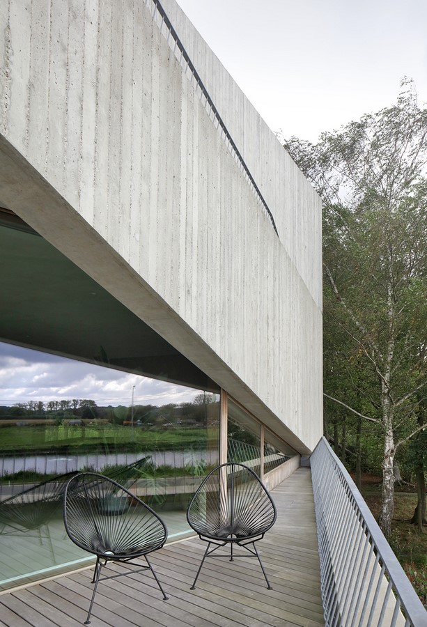 Belgian House Featuring Asymmetrical Angled Concrete Canopies designed by GRAUX & BAEYENS Architecten - Sheet9