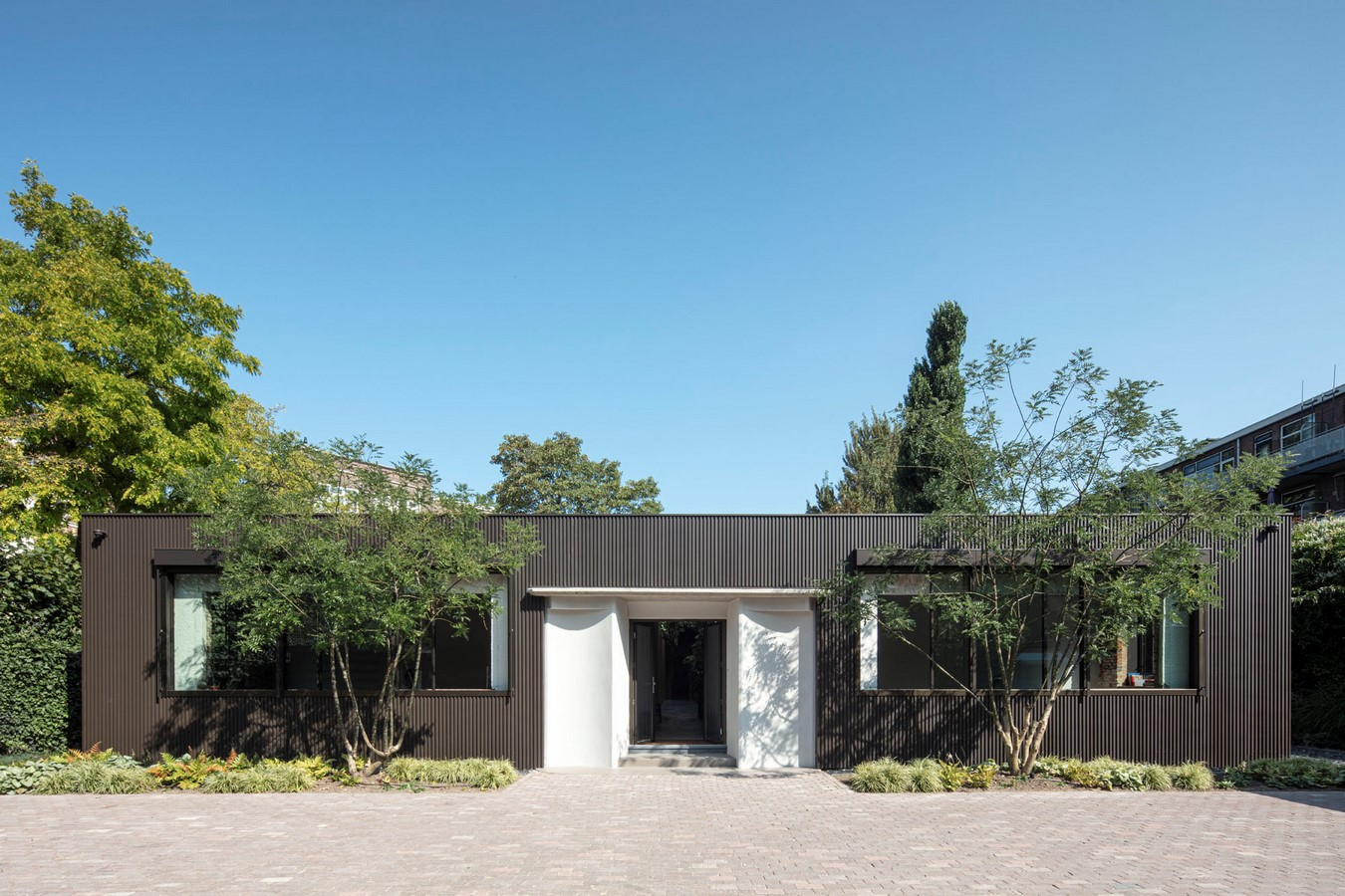 Abandoned 1940s Sports Building converted into New Villa With Naked Brick Walls by MASA Architects - Sheet1
