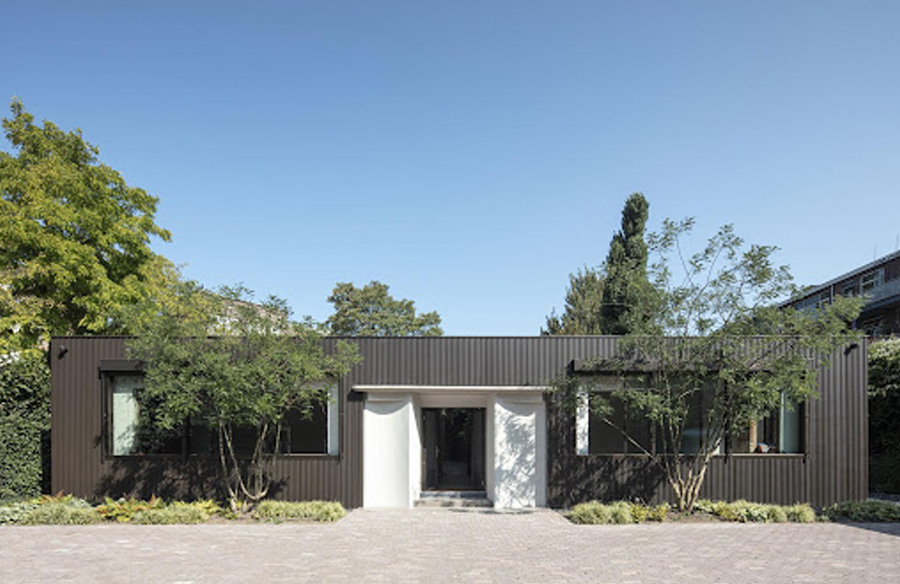 Abandoned 1940s Sports Building converted into New Villa With Naked Brick Walls by MASA Architects